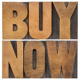 Buy now in wood type Stock Photos
