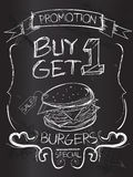 Buy one Get one Burgers on blackboard Stock Image