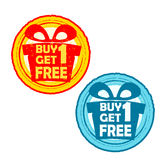 Buy one get one free with gift signs, yellow red and blue drawn. Buy one get one free with gift signs - text in yellow red and blue drawn label with present box Royalty Free Stock Images