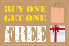 Buy one Get one Free label or tag vector with shopping bag. And gift box isolated on white background Royalty Free Stock Photo