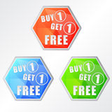 Buy one get one free, three colors hexagons labels. Flat design, business shopping concept Royalty Free Stock Photos