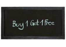 Buy one get one Free type on Chalkboard background. Isolated stock images
