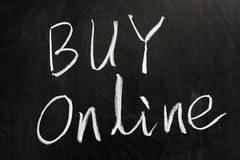 Buy online. Chalk drawing - \Buy online\ word on the chalkboard Stock Photos