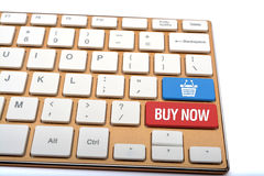 Buy online with basket icon on keyboard close up Stock Photos