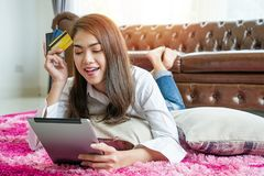Buy online concepts Women use tablets to shop online. She`s interested to buy stock images