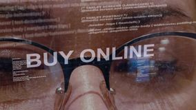 Buy Online text on background of female developer stock footage
