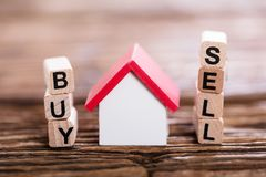 Free Buy Or Sell Option With Small House Model Stock Image - 103346821