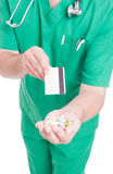 Buy pills and pay with debit or credit card Royalty Free Stock Image
