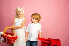 Buy products. Play shop game. Cute buyer customer client hold shopping cart. Buy with discount. Girl and boy children. Shopping. Couple kids hold plastic royalty free stock image