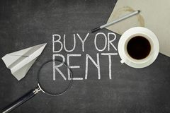 Buy or rent concept on black blackboard with empty Royalty Free Stock Images