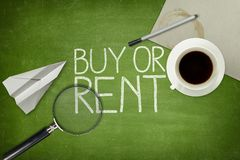 Buy or rent concept on blackboard with empty paper Stock Photography