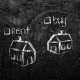Buy or Rent house on blackboard Royalty Free Stock Images