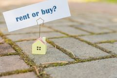 Buy or rent property concept. new House as wish .Text message Buy or rent with wooden small house. Business concept stock photos