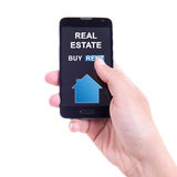 Buy or rent - smart phone with real estate application in male h Royalty Free Stock Photography