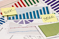 Buy or Sell on charts. Buy or Sell decision on charts and graphs stock photography