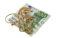 Buy and sell gold. Several pieces of gold over a hundred euro bills stock photography