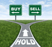 Buy Sell or Hold. Buy and sell or hold decision dilemma crossroads of financial investing using a stock broker investment adviser and a symbol of difficult Stock Image