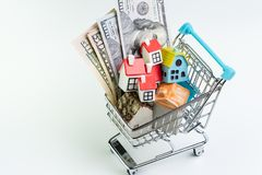 Buy and sell house, property demand and supply or real estate purchasing concept, shopping cart or trolley with full of small cute stock photography