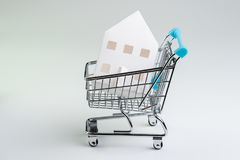 Buy and sell house, property demand and supply or real estate purchasing concept, shopping cart or trolley with full of small cute stock image