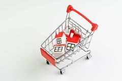 Buy and sell house, property demand and supply on real estate purchasing concept, shopping cart or trolley with full of small cute royalty free stock photos