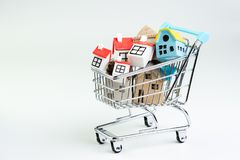 Buy and sell house, property demand and supply on real estate purchasing concept, shopping cart or trolley with full of small cute stock images