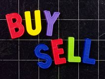 Buy Sell magnetic colorful letters on blackboard chalkboard Royalty Free Stock Photography