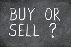Buy or sell question on blackboard. Buying or selling question mark. Finance, economy, stock or real estate concept - time to buy or sell royalty free stock image