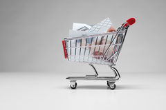 Buy stock photo. Stock (microstock) photos concept. Shopping cart with printed stock photos Stock Photo
