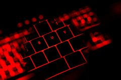 Buy text on the illuminated buttons of the keyboard. By night. Internet shopping concept Stock Images