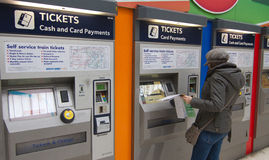 Buy train tickets from automatic vending machine Stock Images