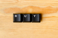 Buy word. With keyboard buttons Stock Photos