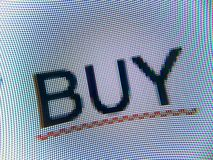 Buy. The word BUY written on a screen stock photography