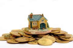 Buy your Dream House concept with Golden Coins stack Stock Photo