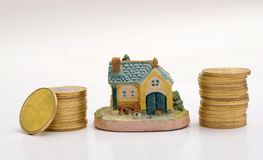 Buy your Dream House concept with Golden Coins stack Stock Images