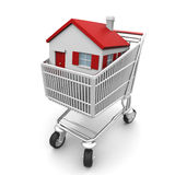 Buy Your House. 3D house in a shopping cart isolated on white Royalty Free Stock Image