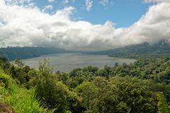 Buyan Lake in Bali. Lake Buyan is a caldera lake located in Buleleng Regency, Bali. The lake is located at the foot of Mount Lesung. The lake is one of the three Royalty Free Stock Photo