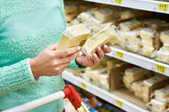 Buyer chooses cheese in store Royalty Free Stock Photography