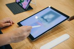 The buyer chooses to buy a new iPad in the official store of Apple in Berlin. Berlin, August 29, 2018: The buyer chooses to buy a new iPad in the official store Stock Images
