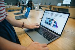 The buyer chooses to buy a new MacBook in the official store of Apple in Berlin. stock images