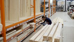 Buyer in the construction shop. The girl came to the hardware store and makes purchases stock video footage