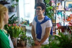 Buyer in flower-shop Stock Photos