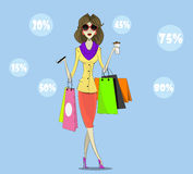 Buyer. Girl with shopping bags Royalty Free Stock Images