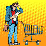 The buyer with a grocery cart. The trip to the store. Shopping list. Husband in the store Royalty Free Stock Photo