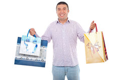 Buyer man with shopping bags. Buyer man holding shopping bags and smiling isolated on white background royalty free stock image