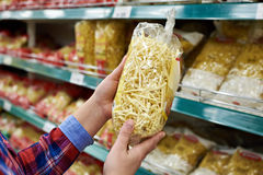 Buyer with package pasta in shop Royalty Free Stock Photos