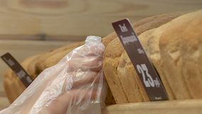 The buyer pays for the purchase in the store stock footage