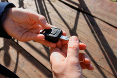 Buyer`s hand taking a car key Stock Image