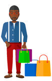 Buyer with shopping bags Stock Images