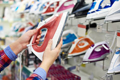 Buyer shopping for iron in store Royalty Free Stock Images