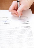 Buyer signs an agreement by silver pen Royalty Free Stock Images